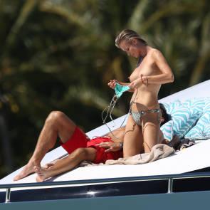 Joanna Krupa topless adjusting bra