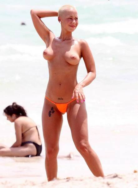 ... skin. Guided by this thought Amber Rose got topless on the beach: scandalplanet.com/amber-rose-topless-on-the-beach