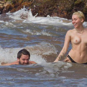 Miley Cyrus Topless on with boyfriend on beach