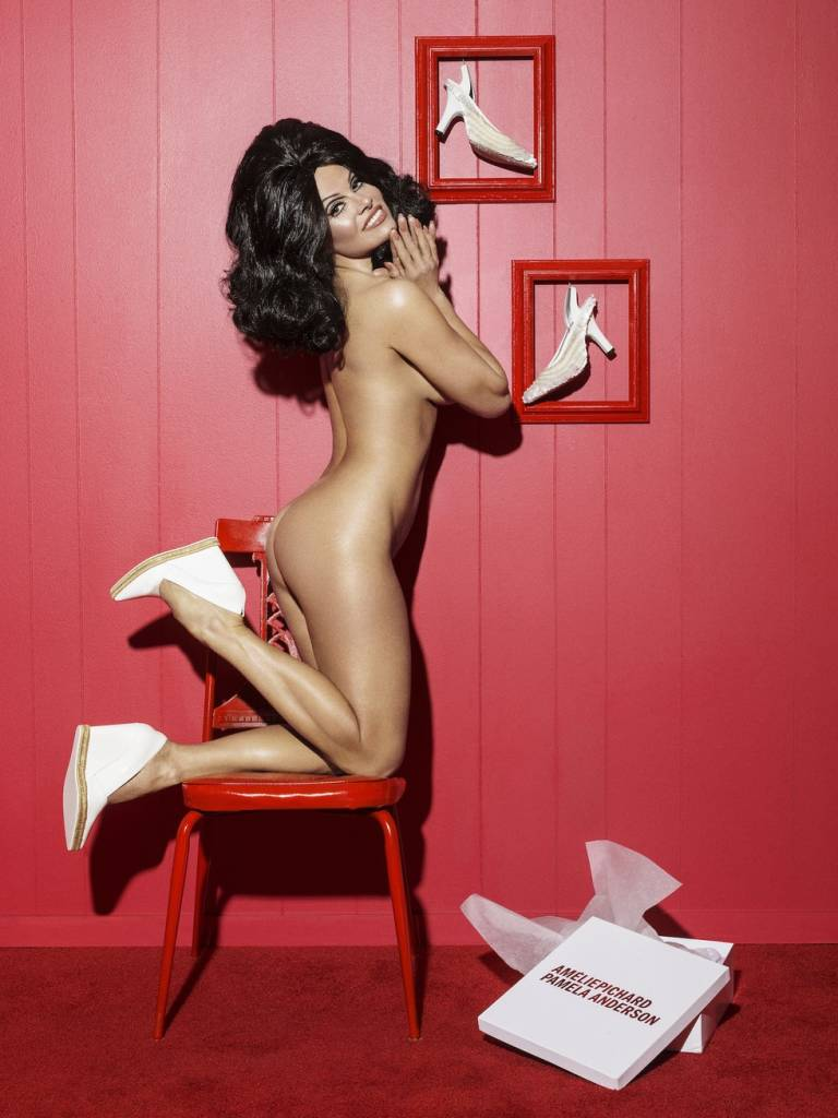 Pamela Anderson Ass Showing while standing on chair