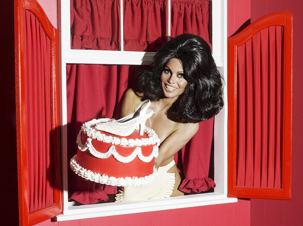 Pamela Anderson Holding Cake