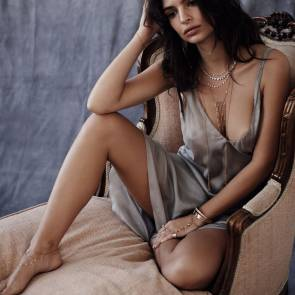 emily ratajkowski sitting in chair in a see through dress