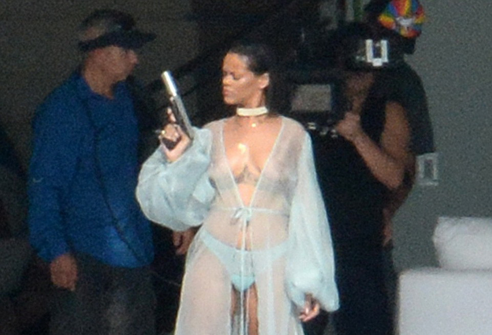 rihanna topless exposing holding a gun