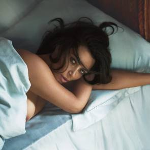 Kim kardashian lying naked in bed covered, nipple slipping