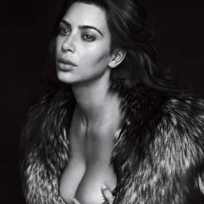 Kim kardashian naked in a fur coat only covering her boobs with hands