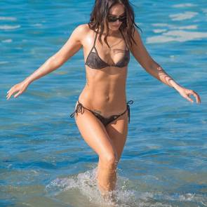 Megan Fox hot at beach getting out of ocean