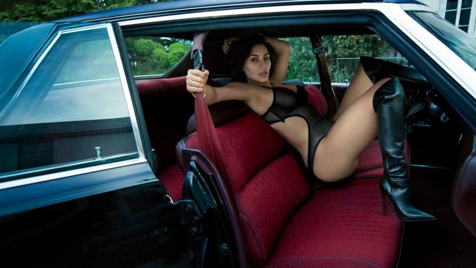kim kardashian in a car with showing boobs in see through bra