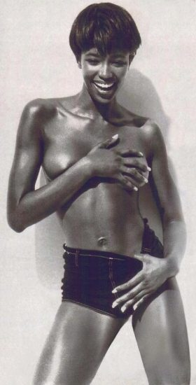 naomi campbell covering her boobs with hands