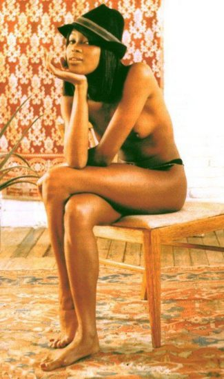 naomi campbell sitting in topless