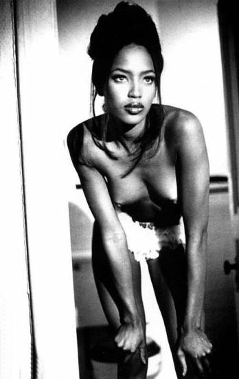 naomi campbell with naked boobs band over while holding knees