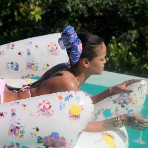 rihanna drinking vine and sunbathing