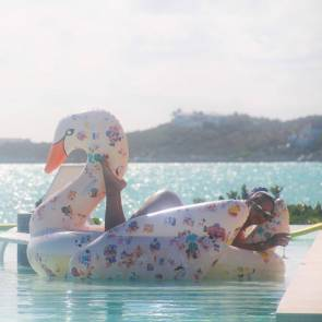rihanna hot lying on floating swan