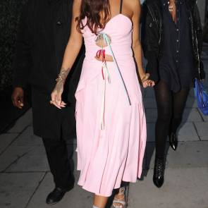 rihanna in pink dress holding hands with her friend
