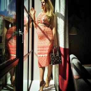 Blake Lively In beautiful Coral dress standing by the window