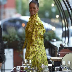 Rihanna smiling while leaving coffie shop