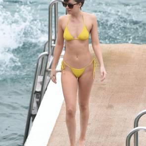dakota johnson in yellow bikini on the docks