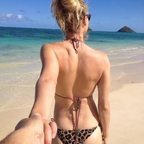Yvonne Strahovski At Beach holding boyfriend's hand