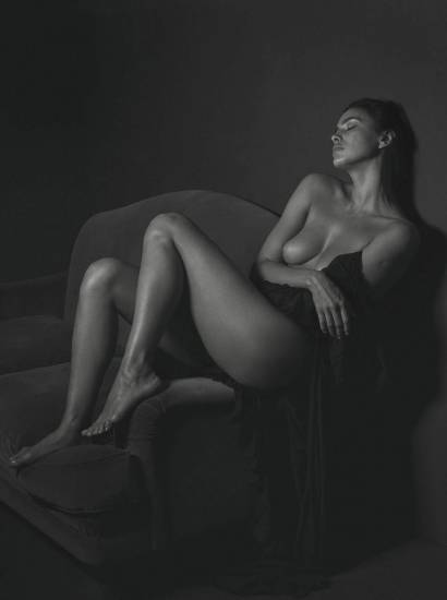Irina Shayk boobs while sitting in chair
