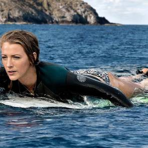 blake lively paddles surfer board