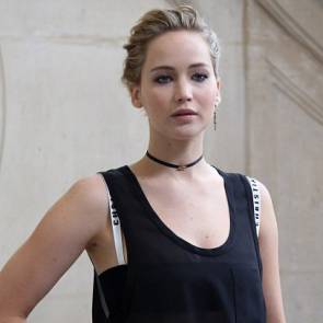 Jennifer Lawrence and Sidney Toledano head of the Dior fashion show