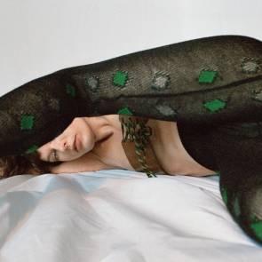 Milla Jovovich Spreading Legs On Bed