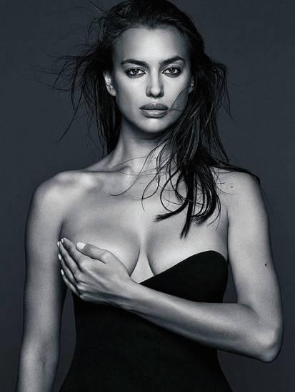 irina shayk holding one boob with hand