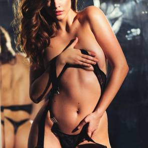 Barbara Palvin topless covering boobs with arm