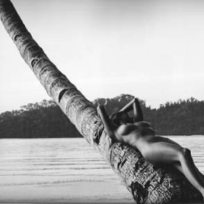 Genevieve Morton lying on the palm tree