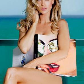 Joanna Krupa covered with book