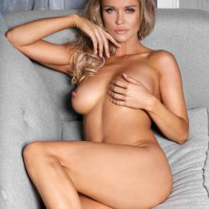 Joanna Krupa covers one boob with hand