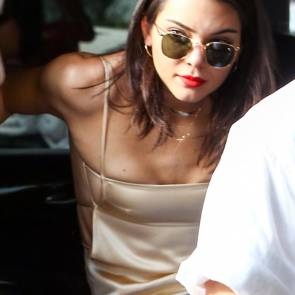 Kendall Jenner boobs almost popping out of her top
