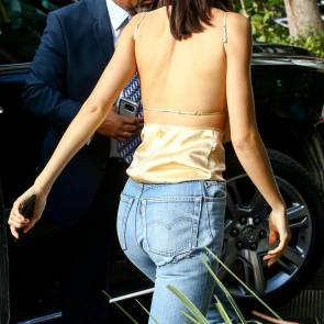 Kendall Jenner from behind in small top and jeans