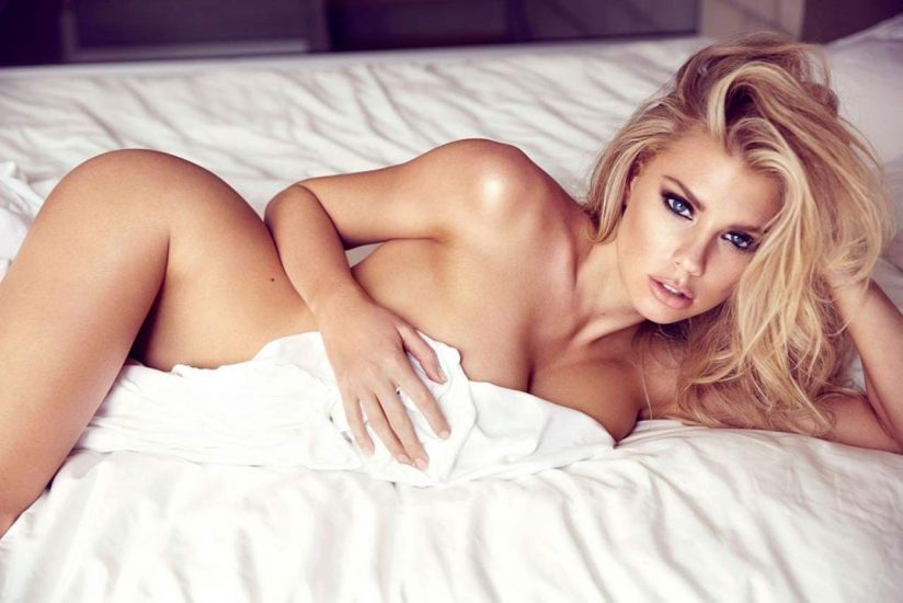 Charlotte McKinney nude laying on bed