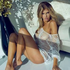 Charlotte McKinney on floor with naked boobs