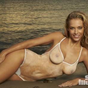 Hannah Ferguson lying on the beach naked