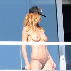 Heidi Klum caught topless