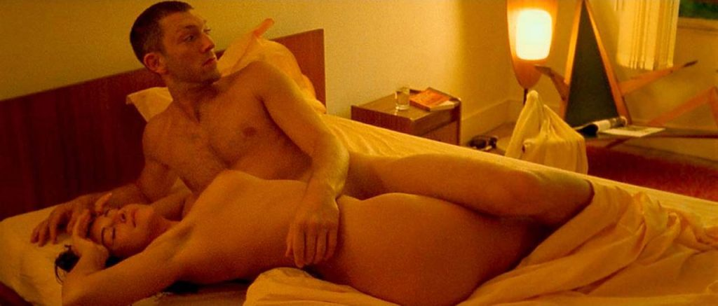 Monica Bellucci naked with a guy in bed