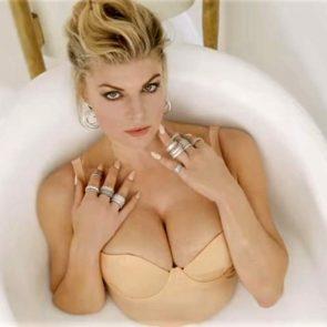 Fergie sexy beige bra lying in milk