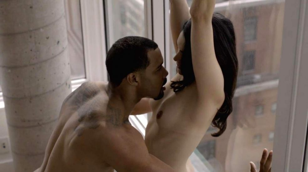 Lela Loren topless against the window