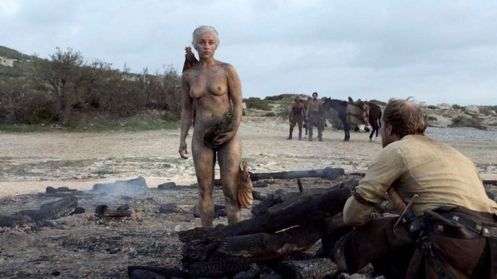 Emilia Clarke standing naked after fire with her dragons