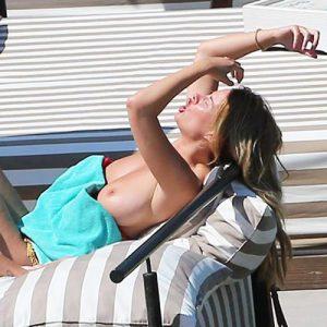 Model Rhian Sugden Topless Sunbathing in Ibiza