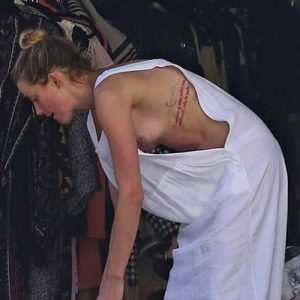 Disgusting ! Amber Heard Nip Slip and Face Full of Acne !