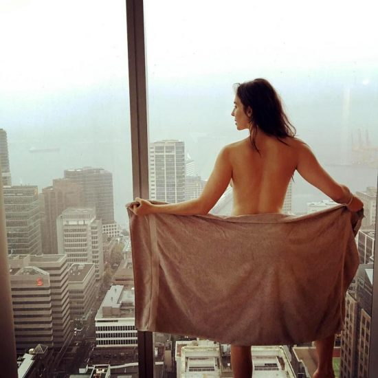 Whitney Cummings nude beside the window