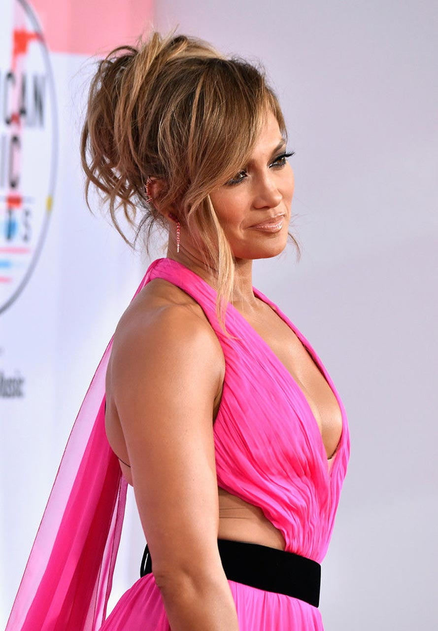 Jennifer Lopez Shows Cleavage as she arrives ate Billboard