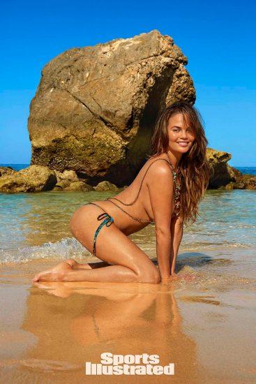Chrissy Teigen topless in water