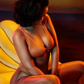 Rihanna deep cleavage in beige lingerie