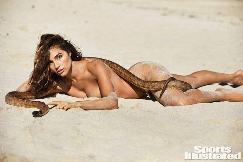 Olivia Culpo lying naked