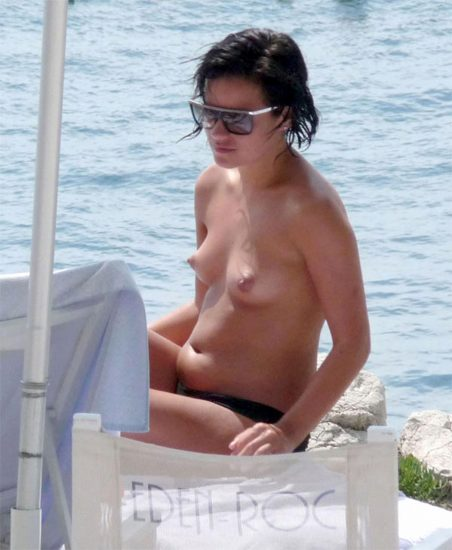 Lily Allen topless on beach