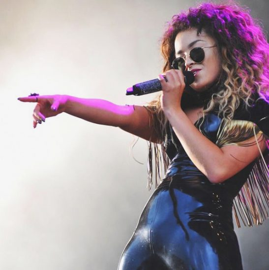 Ella Eyre singing on the stage