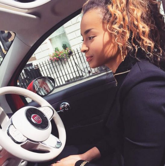 Ella Eyre sexy while driving her car